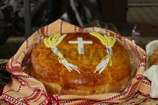 Freshly baked homemade bread arranged in traditional Bulgarian textiles. Image of some tasty Home-made bakery products.