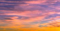 sunset sky with beautiful orange and pink and blue colors