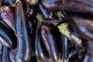 Dark purple aubergine texture background.
