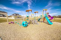 Kids playground with colorful blue slides during day