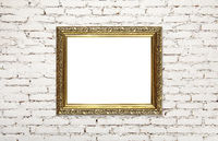Antique golden picture photo frame on brick wall
