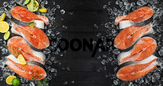 Fresh salmon steaks on ice, on black background. Top view. Copy space