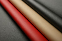 Background of black, red and beige white leather