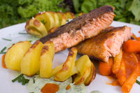 grilled salmon with potatoes and vegetables