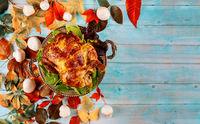 Golden roast chicken with thanksgiving celebration dinner