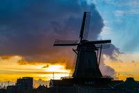 Silhouette of dutch windmill in the village of Zaanse Schans