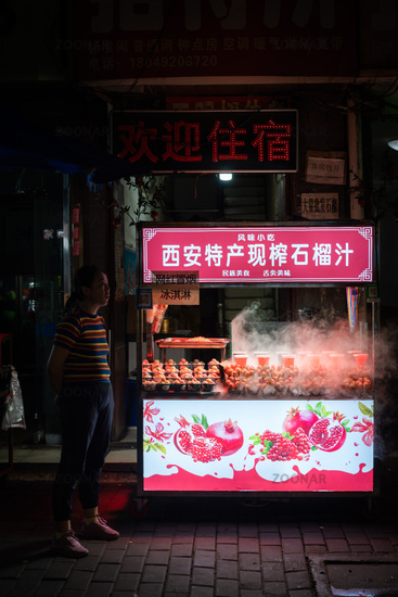 Fresh juice stall operating at night