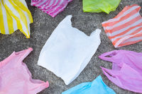 Colorful disposable plastic bags  on cement