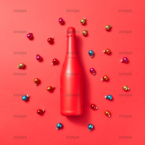 Holiday composition red painted mockup bottle on a Christmac background.