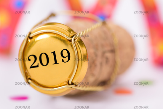 cork of champagne with new year`s date 2019 and copy space