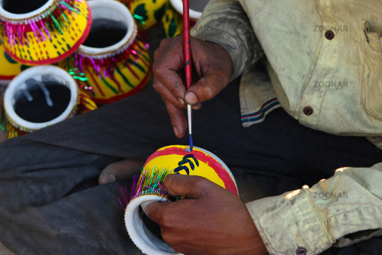 Person painting pots