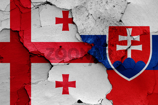 flags of Georgia and Slovakia painted on cracked wall