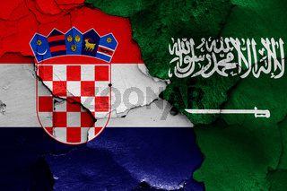 flags of Croatia and Saudi Arabia painted on cracked wall