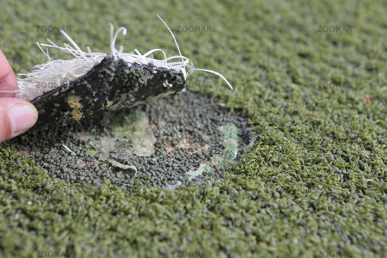Damaged artificial turf