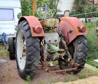 a parked old tractor from the GDR