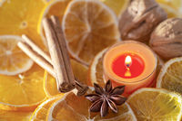 Christmas decoration - orange slices, candle and spices