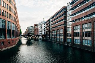 Cityscape of Hamburg in Bleichenfleet canal at dusk