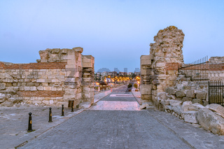 Entrance gates in the Nessebar ancient city at sunrise on the Bulgarian Black Sea Coast. Nesebar, Nesebr is a UNESCO World Heritage Site. Ruins at sunrise in Nessebar, Bulgaria
