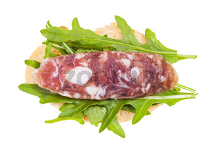 sandwich with bread, cured sausage and arugula