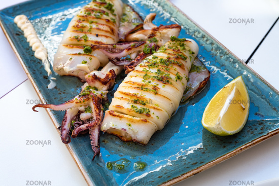 Delicious plate of grilled squid at gourmet restaurant