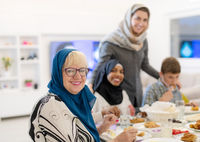 modern multiethnic muslim family having a Ramadan feast