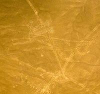Aerial airplane panoramic view to Nazca geoglyph lines aka Dog, Ica, Peru