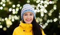 happy young woman in winter clothes outdoors
