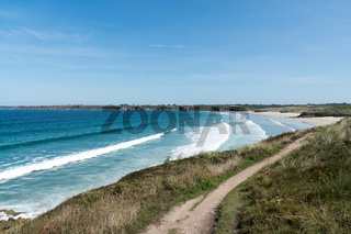 surfable waves from a ground swell roll into the Blancs Sablons beach on the coast of Brittany in France