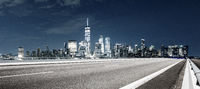 empty asphalt highway with modern cityscape new york at night