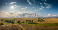 Panorama of a beautiful landscape with windmills when the weather is good