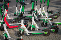 Many Electric E scooters , escooter or e-scooter  on sidewalk in Berlin