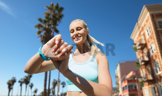 woman with fitness tracker exercising outdoors