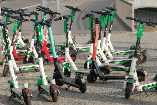 Many Electric E scooters , escooter or e-scooter  on street  in Berlin