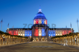 San Francisco City Hall illuminated in Memorial Day Colors.