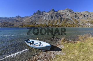 Lake with boat in autumn