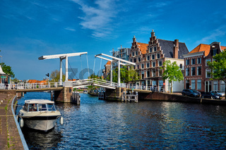 Spaarne river with boat and Gravestenenbrug bridge in Haarlem, N