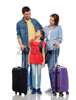 happy family with travel bags