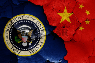 flags of President of the United States and China painted on cracked wall