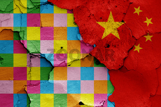 depiction of Lennon wall flag and China painted on cracked wall