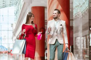 Elegant couple shopping in store