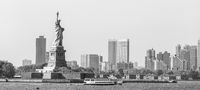 Statue of Liberty with Liberty State Park and Jersey City skyscrapers in background, USA