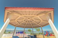 Octagon shape pavilion and playground with lake and Timpanogos mountains view