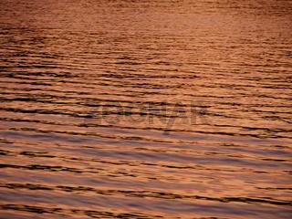 glare on golden water