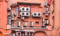 Air conditioner machines on old wall