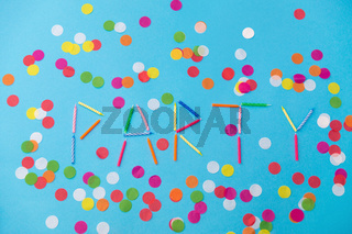 word party made of birthday candles on blue