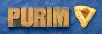 Purim word in wood type with hamantaschen cookie
