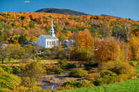 Iconic New England church in Stowe town at autumn