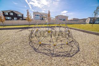 Kids climbing dome in an urban playground