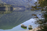 Autumn mood, rowboats on the shore of the Sylvenstein reservoir, Bavaria, Germany
