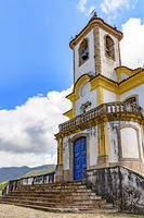 Ancient historical catholic church facade and hills in Ouro Preto city